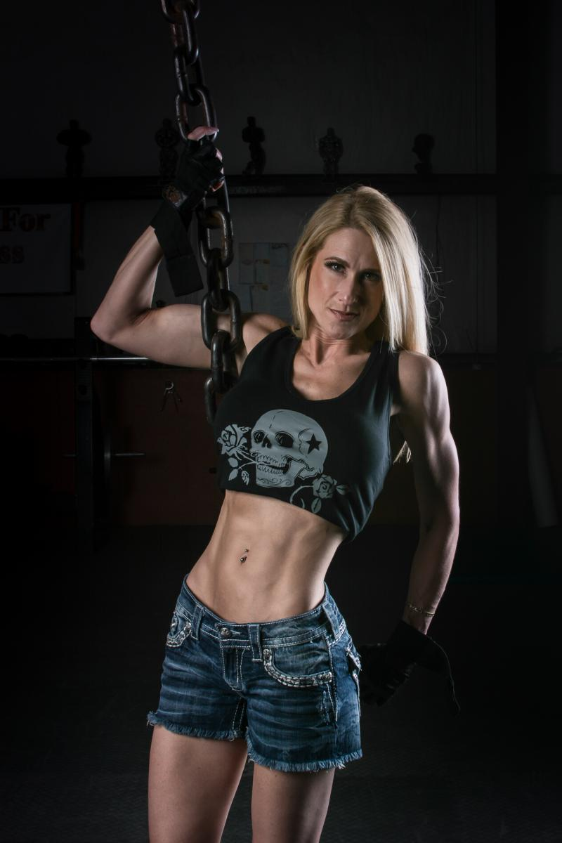 Fitness photographer holding chains in Jacksonville, nC